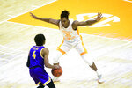 Tennessee's Yves Pons (35) guards Tennessee Tech's Jr. Clay (4) during an NCAA college basketball game in Knoxville, Tenn., Friday, Dec. 18, 2020. (Caitie McMekin/Knoxville News Sentinel via AP, Pool)
