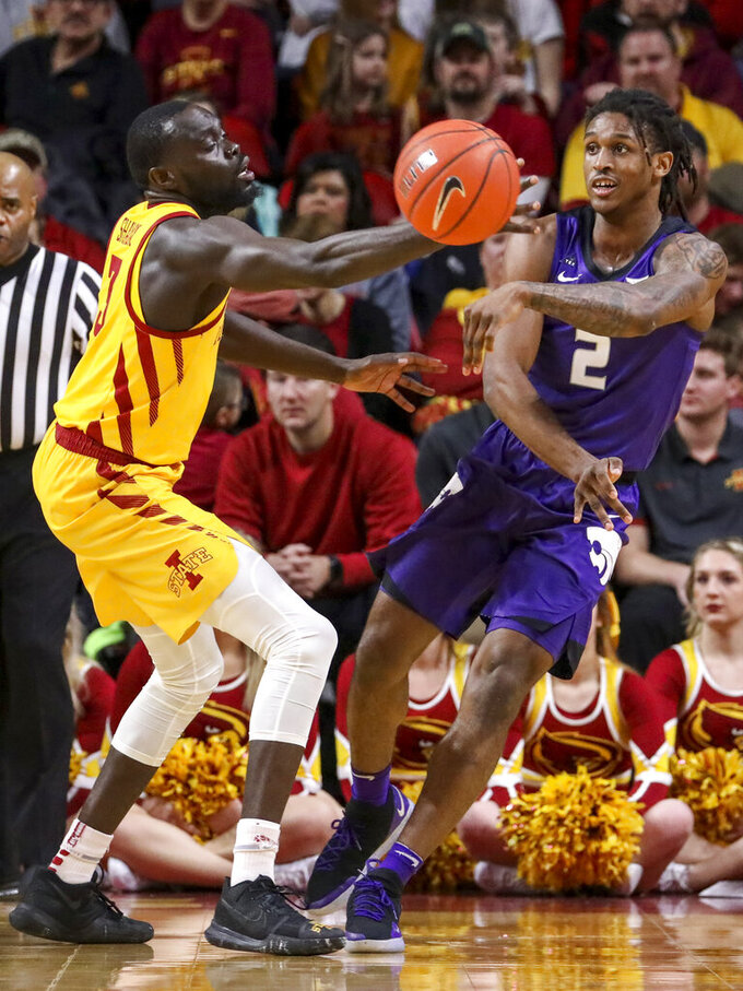 Iowa State guard Marial Shayok tries to block the pass of Kansas State guard Cartier Diarra during the first half of an NCAA college basketball game, Saturday, Jan. 12, 2019, in Ames, Iowa. (AP Photo/Justin Hayworth)