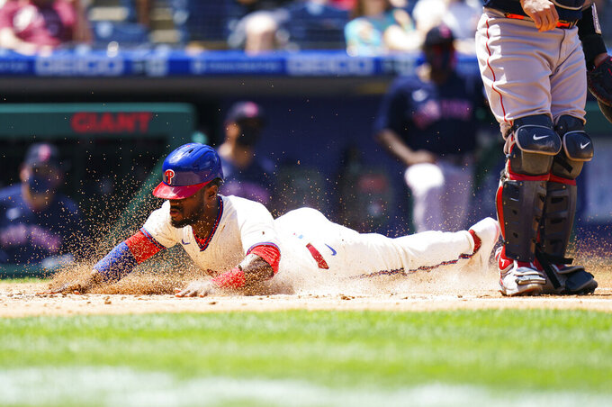 Philadelphia Phillies' Odubel Herrera slides safely home on a hit by Rhys Hoskins during the first inning of a baseball game against the Boston Red Sox, Sunday, May 23, 2021, in Philadelphia. (AP Photo/Chris Szagola)