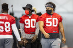 Tampa Bay Buccaneers defensive tackle Vita Vea walks between drills during NFL football practice, Tuesday, Feb. 2, 2021 in Tampa, Fla. The Buccaneers will face the Kansas City Chiefs in Super Bowl 55. (Tori Richman/Tampa Bay Buccaneers via AP)