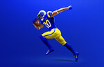 This undated graphic image released by the Los Angeles Rams NFL football team shows a model in their 'royal' uniform color scheme. The Rams unveiled new uniforms ahead of their move into SoFi Stadium this year. (Los Angeles Rams via AP)