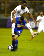 United States' Jordan Pefok, top, and El Salvador's Alex Roldan, fight for the ball during a qualifying soccer match for the FIFA World Cup Qatar 2022 at Cuscatlan stadium in San Salvador, El Salvador, Thursday, Sept. 2, 2021. (AP Photo/Moises Castillo)
