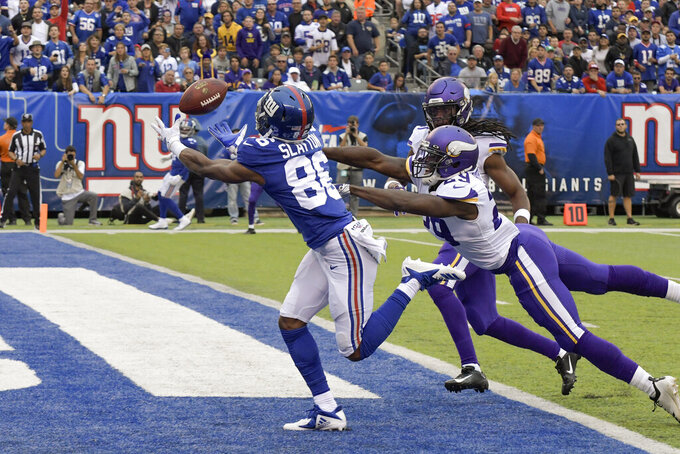 New York Giants wide receiver Darius Slayton (86) makes a touchdown catch against Minnesota Vikings cornerback Xavier Rhodes (29) during the second quarter of an NFL football game, Sunday, Oct. 6, 2019, in East Rutherford, N.J. (AP Photo/Bill Kostroun)