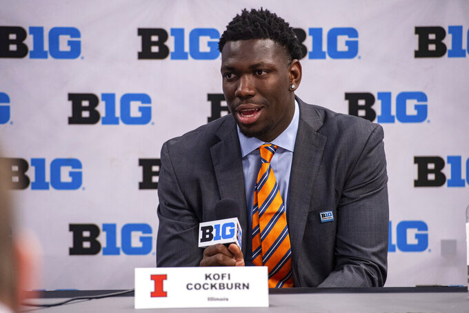 Illinois' Kofi Cockburn addresses the media during the first day of the Big Ten NCAA college basketball media days, Thursday, Oct. 7, 2021, in Indianapolis. (AP Photo/Doug McSchooler)