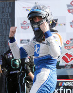 Austin Cindric celebrates his win in the NASCAR Xfinity Series auto race Saturday, Aug. 10, 2019, at Mid-Ohio Sports Car Course in Lexington, Ohio. (AP Photo/Tom E. Puskar)