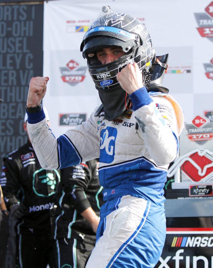 Austin Cindric celebrates his win in the NASCAR Xfinity Series auto race Saturday, Aug. 10, 2019, at Mid-Ohio Sports Car Course in Lexington, Ohio. (AP Photo/Tom E. Puskar)