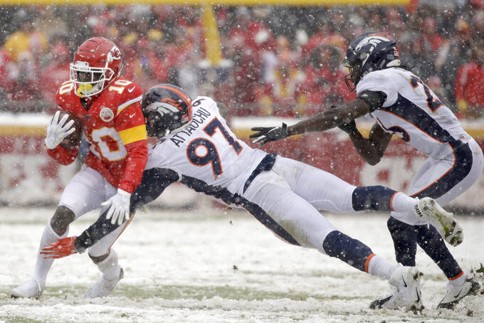Denver Broncos linebacker Jeremiah Attaochu (97) tackles Kansas City Chiefs wide receiver Tyreek Hill (10) during the first half of an NFL football game in Kansas City, Mo., Sunday, Dec. 15, 2019. (AP Photo/Charlie Riedel)