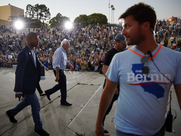 FILE - In this July 26, 2019, file photo, Democratic presidential candidate Sen. Bernie Sanders, I-Vt., leaves a rally at Santa Monica High School Memorial Greek Amphitheater in Santa Monica, Calif. Sanders is promising to win the California presidential primary next year, but home-state Sen. Kamala Harris is preparing to defend her turf.  (AP Photo/Damian Dovarganes, File)