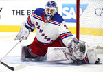 FILE - New York Rangers goalie Henrik Lundqvist makes a save in overtime during an NHL hockey game against the San Jose Sharks in San Jose, Calif., in this Tuesday, Oct. 30, 2018, file photo. Lundqvist, one of the greatest goaltenders of his generation, announced his retirement Friday, Aug. 20, 2021, less than nine months after heart surgery. (AP Photo/Ben Margot, File)