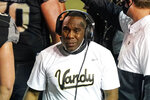"Vanderbilt head coach Derek Mason watches from the sideline in the first half of an NCAA college football game against LSU Saturday, Oct. 3, 2020, in Nashville, Tenn. Southeastern Conference officials continue adapting to navigate setbacks in their pursuit of a league title and possible national championship. ""We hope to get through the end of the season,"