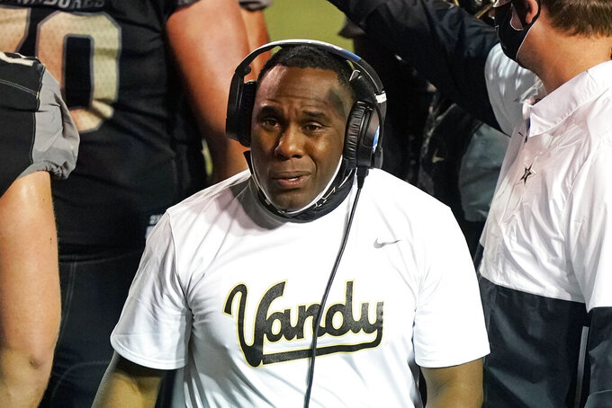 "Vanderbilt head coach Derek Mason watches from the sideline in the first half of an NCAA college football game against LSU Saturday, Oct. 3, 2020, in Nashville, Tenn. Southeastern Conference officials continue adapting to navigate setbacks in their pursuit of a league title and possible national championship. ""We hope to get through the end of the season,"" Vanderbilt coach Derek Mason said of the SEC. ""But I'm not a soothsayer, and I don't have a crystal ball. I'm just trying to go day to day, week to week.""(AP Photo/Mark Humphrey)"