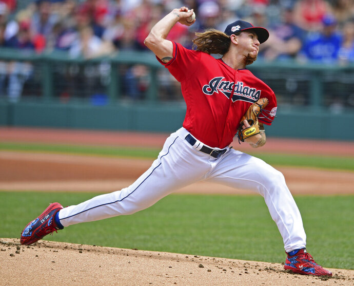 FILE - In this April 7, 2019, file photo, Cleveland Indians starting pitcher Mike Clevinger delivers in the first inning of a baseball game against the Toronto Blue Jays, in Cleveland. Clevinger is rejoining the Indians' rotation sooner than anyone expected. The right-hander, whose season seemed in jeopardy when he strained a muscle in his upper back on April 7, will start Monday, June 17, when Cleveland opens a four-game series at Texas. (AP Photo/David Dermer, File)