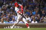 Cincinnati Reds' Jose Iglesias hits an RBI double during the 10th inning of the team's baseball game against the Chicago Cubs on Wednesday, Sept. 18, 2019, in Chicago. The Reds won 3-2. (AP Photo/Charles Rex Arbogast)