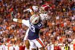 Alabama wide receiver Jaylen Waddle (17) makes a leaping touchdown pass over Auburn defensive back Javaris Davis (13) during the second half of an NCAA college football game, Saturday, Nov. 30, 2019, in Auburn, Ala. (AP Photo/Vasha Hunt)