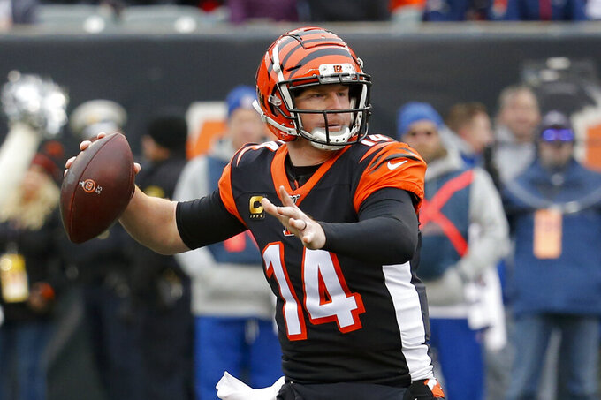 FILE - In this Dec. 15, 2019, file photo, Cincinnati Bengals quarterback Andy Dalton passes in the first half of an NFL football game against the New England Patriots in Cincinnati. The Bengals cleared the way for Joe Burrow to lead the team by releasing quarterback Andy Dalton, who holds several of the franchise's passing records but couldn't lead the woebegone Bengals deep into the playoffs. The move Thursday, April 30, 2020, gives Dalton, who had a year left on his deal, a chance to compete for a job with another team.(AP Photo/Frank Victores, File)