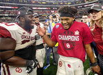 Oklahoma quarterback Kyler Murray, right, celebrates with teammate Neville Gallimore after beating Texas 39-27 in the Big 12 Conference championship NCAA college football game on Saturday, Dec. 1, 2018, in Arlington, Texas. (AP Photo/Jeffrey McWhorter)
