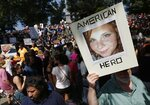 "FILE - In this Aug. 19, 2017, file photo, a counter-protester holds a photo of Heather Heyer on Boston Common at a ""Free Speech"" rally organized by conservative activists, in Boston. Jury selection is set to begin in the trial of James Alex Fields Jr., accused of killing Heyer during a white nationalist rally in Charlottesville in 2017. His trial is scheduled to begin Monday, Nov. 26, 2018, in Charlottesville Circuit Court. (AP Photo/Michael Dwyer, File)"