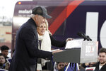 Jill Biden removes her notes after introducing her husband, Democratic presidential candidate and former Vice President Joe Biden during a campaign stop in Council Bluffs, Iowa, Saturday, Nov. 30, 2019. (AP Photo/Nati Harnik)
