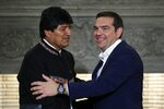 Greece's Prime Minister Alexis Tsipras, right, shakes hands with Bolivia's President Evo Morales after their press conference at Maximos Mansion in Athens, Friday, March 15, 2019. Bolivia's left-wing president on Thursday compared Venezuelan opposition leader Juan Guaido to an erstwhile colonial viceroy and spoke out against any military intervention in the troubled country. (AP Photo/Thanassis Stavrakis)