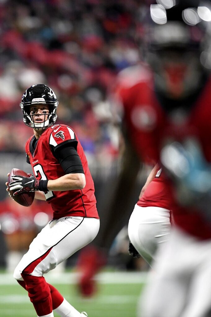 Atlanta Falcons quarterback Matt Ryan (2) works against the Jacksonville Jaguars during the first half of an NFL football game, Sunday, Dec. 22, 2019, in Atlanta. (AP Photo/Danny Karnik)