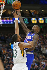 Sacramento Kings center Dewayne Dedmon shoots as Utah Jazz center Tony Bradley (13) defends during the first half of an NBA basketball game Saturday, Jan. 18, 2020, in Salt Lake City. (AP Photo/Rick Bowmer)
