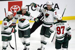 Minnesota Wild defenseman Jonas Brodin, second from left, of Sweden, celebrates with defenseman Jared Spurgeon, left, center Nick Bjugstad, second from right, and left wing Kirill Kaprizov, right, of Russia, after scoring against the Los Angeles Kings during the first period of an NHL hockey game in Los Angeles, Thursday, Jan. 14, 2021. (AP Photo/Alex Gallardo)