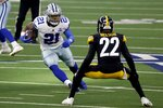Dallas Cowboys running back Ezekiel Elliott (21) carries the ball as Pittsburgh Steelers' Steven Nelson (22) attempts to make a a stop in the first half of an NFL football game in Arlington, Texas, Sunday, Nov. 8, 2020. (AP Photo/Ron Jenkins)