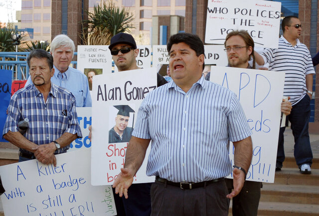 FILE - In this March 28, 2012, file photo, then-LULAC New Mexico state director Ralph Arellanes speaks at a rally in Albuquerque, N.M., calling for a federal probe of the Albuquerque Police Department following a number of officer-involved shootings. Arellanes, now the executive director of New Mexico LULAC, called the University of New Mexico, on Monday, July 20, 2020, to end its support for Chicano and Native American Studies because he's upset the state is taking down monuments connected to Spanish conquistadors. (AP Photo/Russell Contreras, File)