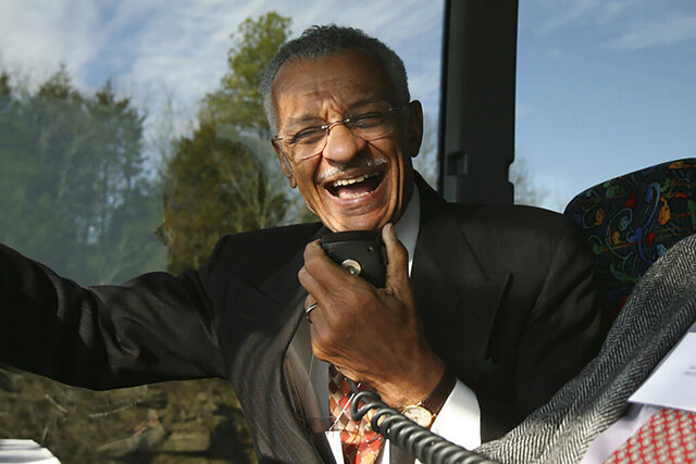 FILE - In this Jan. 27, 2007, file photo, C.T. Vivian uses an intercom with Rev. James Lawson on a bus in Montgomery, Ala., to discuss the experiences they encountered in 1961 as Freedom Riders, a group of college students who defied segregation on interstate buses across the American South. The Rev. Vivian, a civil rights veteran who worked alongside the Rev. Martin Luther King Jr. and served as head of the organization co-founded by the civil rights icon, has died at home in Atlanta of natural causes Friday morning, July 17, 2020 his friend and business partner Don Rivers confirmed to The Associated Press. Vivian was 95. (Lavondia Majors/The Tennessean via AP)