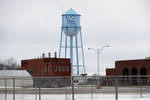 FILE - In this March 12, 2019 file photo, the water tower stands over the Veterans Affairs campus, in Knoxville, Iowa. After watching for more than a decade as a once busy Veterans Affairs campus deteriorated into a sprawling ghost town, leaders of a small Iowa city announced plans to take control of the property and likely demolish most of the structures. City and county officials signed documents Wednesday, Jan. 15, 2020, taking ownership of the 153-acre property. (AP Photo/Charlie Neibergall, File)