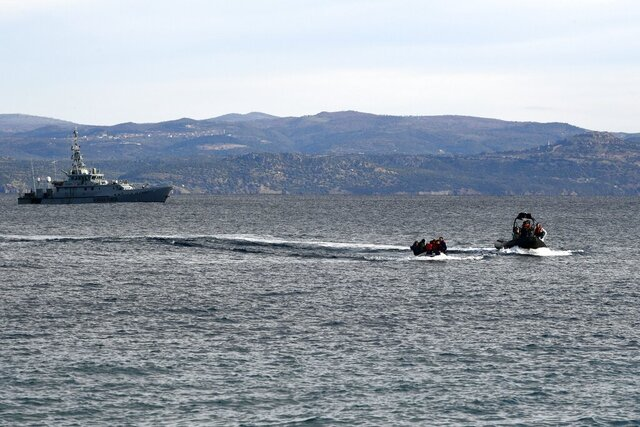 Refugees and migrants arrive with a dinghy accompanied by Frontex vessels at the village of Skala Sikaminias, on the Greek island of Lesbos, after crossing the Aegean sea from Turkey, on Friday, Feb. 28, 2020. An air strike by Syrian government forces killed scores of Turkish soldiers in northeast Syria, a Turkish official said Friday, marking the largest death toll for Turkey in a single day since it first intervened in Syria in 2016. (AP Photo/Micheal Varaklas)