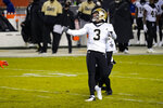New Orleans Saints kicker Wil Lutz (3) watches as his field goal in overtime sails through the goalposts during overtime of an NFL football game in Chicago, Sunday, Nov. 1, 2020. The Saints defeated the Bears 26-23.(AP Photo/Nam Y. Huh)