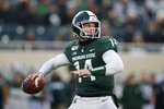 Michigan State quarterback Brian Lewerke looks to throw against Maryland during the first half of an NCAA college football game, Saturday, Nov. 30, 2019, in East Lansing, Mich. (AP Photo/Al Goldis)