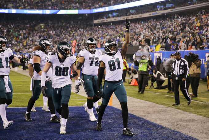 Philadelphia Eagles tight end Josh Perkins (81) celebrates scoring a touchdown in the first half of an NFL football game against the New York Giants, Sunday, Dec. 29, 2019, in East Rutherford, N.J. (AP Photo/Seth Wenig)