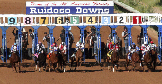 FILE - In this Sept. 6. 2010 file photo, horses compete in the 52nd All-American Futurity at Ruidoso Downs Racetrack and Casino in Ruidoso, N.M. New Mexico's multimillion-dollar horse racing industry could resume live racing if strict protocols were imposed, a group of horse owners said Thursday, April 16, 2020, as state racing regulators discussed the fiscal implications of the industry remaining idle because of the coronavirus outbreak. (Rudy Gutierrez/El Paso Times via AP,File)