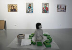 """Some exhibits are laid out in rooms at the Ujazdowski Castle Center for Contemporary Art in Warsaw, Poland, Wednesday Aug. 25, 2021. The exhibition which opens Friday at the Polish state museum features the works of provocative artists in what organizers describe as a celebration of free speech, and a challenge to political correctness and """"cancel culture"""" on the political left. Some critics, however, accuse the organizers of the show titled """"Political Art"""" of giving a platform to anti-Semitic, racist and Islamophobic messages. (AP Photo/Czarek Sokolowski)"""