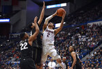 Connecticut's James Bouknight shoots over Central Florida's Darin Green Jr, left, and Central Florida's Frank Bertz, center, in the first half of an NCAA college basketball game, Wednesday, Feb. 26, 2020, in Hartford, Conn. (AP Photo/Jessica Hill)