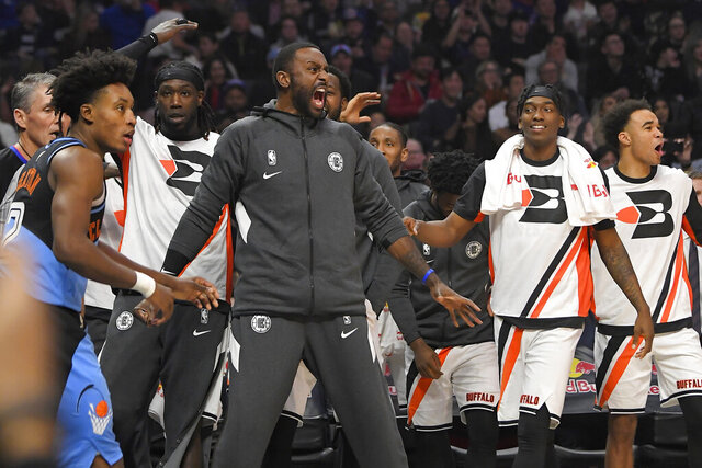 FILE - Members of the Los Angeles Clippers celebrate from the bench as Cleveland Cavaliers guard Collin Sexton, left, walks away during the second half of an NBA basketball game in a Tuesday, Jan. 14, 2020 file photo, in Los Angeles. At the NBA restart, where the only fans inside the building are the ones wearing uniforms, enthusiasm from players on the bench is most definitely getting noticed. (AP Photo/Mark J. Terrill, File)