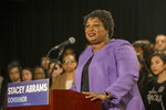 Georgia gubernatorial candidate Stacey Abrams makes remarks during a press conference at the Abrams Headquarters in Atlanta, Friday, Nov. 16, 2018. Democrat Stacey Abrams says she will file a federal lawsuit to challenge the