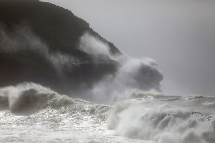Waves crash against the rocks outside Horta, in the Portuguese island of Faial, Wednesday, Oct. 2, 2019. Hurricane Lorenzo powered across the Atlantic Ocean on Wednesday, lashing the Azores archipelago with heavy rains, powerful winds and high waves and significantly damaging one island's main port. (AP Photo/Joao Henriques)