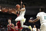 Miami guard Harlond Beverly, center, goes to the basket as North Carolina State forward Danny Dixon (21) and guard C.J. Bryce, center, defend during the second half of an NCAA college basketball game, Wednesday, Feb. 5, 2020, in Coral Gables, Fla. North Carolina State won 83-72. (AP Photo/Lynne Sladky)