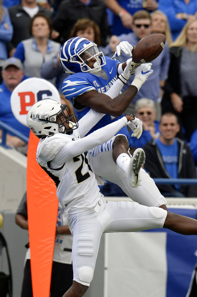 FILE - In this Oct. 13, 2018, file photo, Central Florida defensive back Brandon Moore (20) breaks up a pass intended for Memphis wide receiver Damonte Coxie (10) during the first half of an NCAA college football game, in Memphis, Tenn. The seventh-ranked Knights (11-0, 8-0, No. 8 CFP) are one victory away from their second straight American Athletic Conference championship, a likely New Year's Six bowl bid and bolstering their argument that they are deserving of consideration for a berth in the College Football Playoff. None of that is possible, though, without beating Memphis (8-4, 5-3) in Saturday's AAC title game. (AP Photo/Mark Zaleski, File)