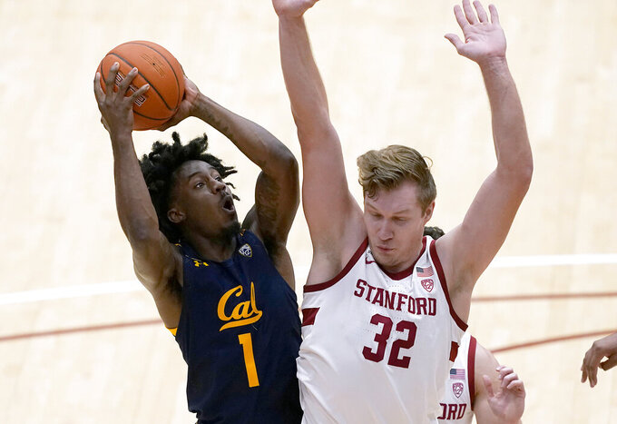 California guard Joel Brown (1) is fouled by Stanford forward Lukas Kisunas (32) during the second half of an NCAA college basketball game in Stanford, Calif., Sunday, Feb. 7, 2021. (AP Photo/Tony Avelar)
