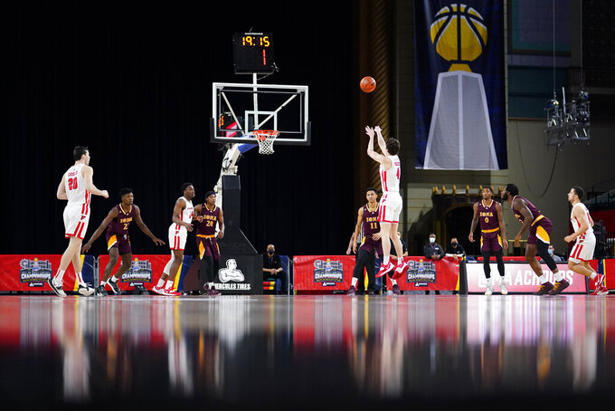 Fairfield's Jake Wojcik (4) goes up for a shot against Iona's Dwayne Koroma (11) in the first half of an NCAA college basketball game during the finals of the Metro Atlantic Athletic Conference tournament, Saturday, March 13, 2021, in Atlantic City, N.J. (AP Photo/Matt Slocum)