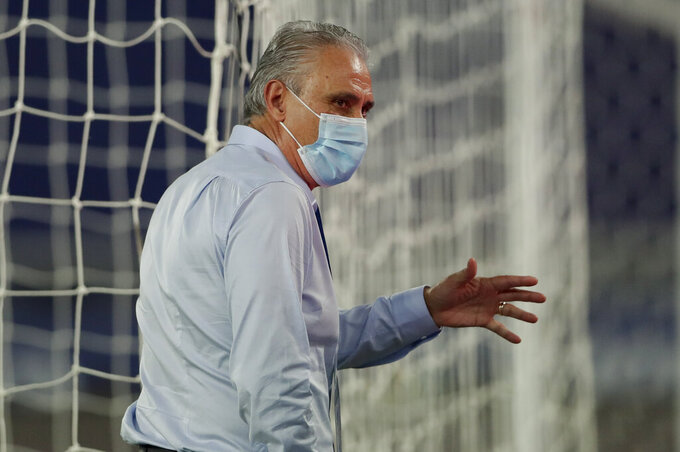 Brazil's coach Tite stands in the pitch prior to a Copa America soccer match against Colombia at Nilton Santos stadium in Rio de Janeiro, Brazil, Wednesday, June 23, 2021. (AP Photo/Silvia Izquierdo)