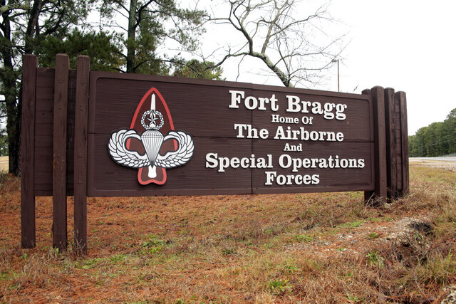 FILE - This Jan. 4, 2020 file photo shows a sign for at Fort Bragg, N.C.  The fight over removing the names of Confederate generals from U.S. Army bases, like Fort Bragg in Fayetteville, has become a national debate. But in North Carolina's new 8th Congressional District, which includes Fort Bragg and all of Cumberland County, the issue is much more personal. (AP Photo/Chris Seward, File)