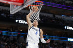 Dallas Mavericks forward Kristaps Porzingis (6) goes up to dunk in the second half of an NBA basketball game against Toronto Raptors in Dallas, Saturday, Nov. 16, 2019. (AP Photo/Tony Gutierrez)