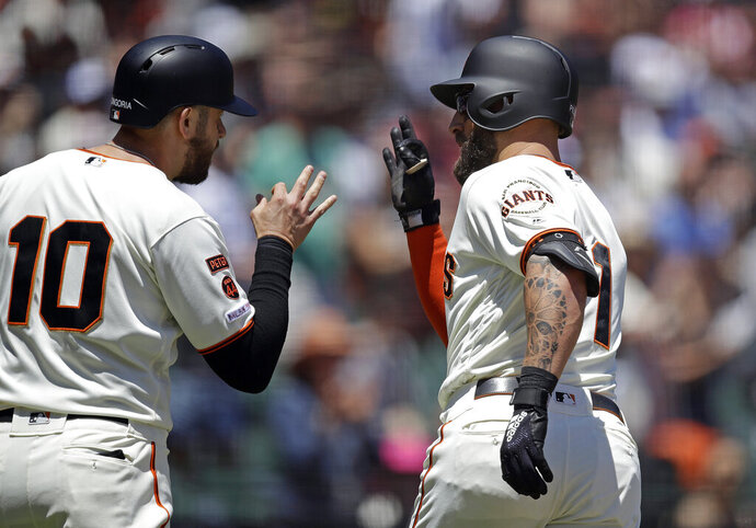 San Francisco Giants' Kevin Pillar, right, celebrates with Evan Longoria (10) after hitting a two-run home run off Arizona Diamondbacks' Robbie Ray in the second inning of a baseball game Sunday, June 30, 2019, in San Francisco. (AP Photo/Ben Margot)