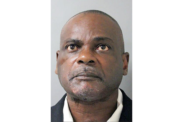 FILE- This undated file photo provided by the Houston Police Department shows Gerald Goines in Houston. Prosecutors say they expect to dismiss at least 91 more drug convictions tied to Goines, a former Houston police officer whose cases are being reviewed following a deadly drug raid. The Thursday, May 21, 2020, announcement comes after the Harris County District Attorney's Office had said in February it would dismiss 73 cases connected to ex-officer Goines.(Houston Police Department via AP, File)