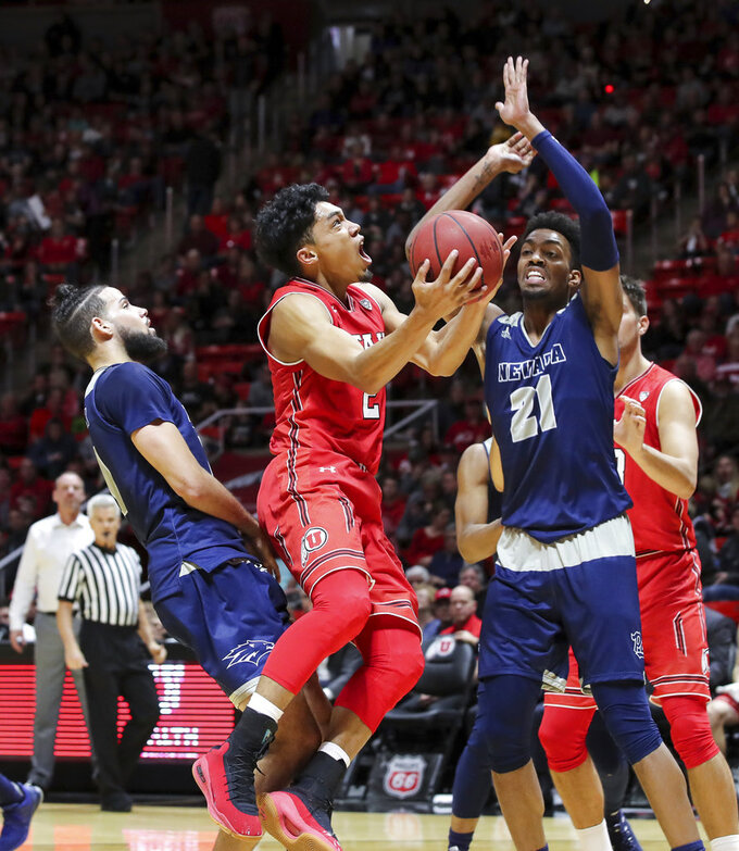 Utah guard Sedrick Barefield (2) shoots the ball between Nevada forwards Caleb Martin (10) and Jordan Brown (21) during the second half of an NCAA college basketball game, Saturday, Dec. 29, 2018, in Salt Lake City. Nevada won 86-71. (AP Photo/Chris Nicoll)